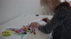 A small girl drawing with a felt-tip pen. Slow motion Stock Footage