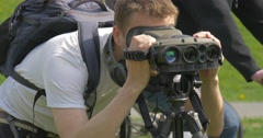 Backpacker is Looking Through Binoculars Smiling Old Weapons Exhibition Stock Footage