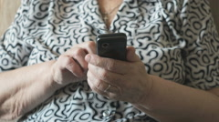 An old woman holding a mobile phone Stock Footage