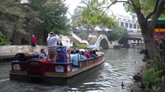 Texas San Antonio River Walk barge goes down river Stock Footage