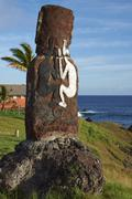Moai statue decorated with traditional artwork on the coast of Rapa Nui Stock Photos