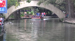 Texas San Antonio River Walk zooms out from barge Stock Footage