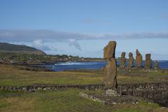 Ancient Moai statues of Ahu Tahai on the coast of Rapa Nui Stock Photos