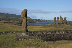 Ancient Moai statues of Ahu Tahai on the coast of Rapa Nui - stock photo