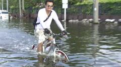 Man Flees Flood on Bike Refugee Emergency Climate Change Global Warming 9515 Stock Footage