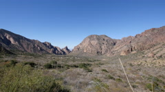Texas Big Bend Chisos pan from basin view Stock Footage