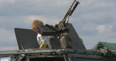 Child Waving Greetings From Hatch of Military Vehicle. Stock Footage