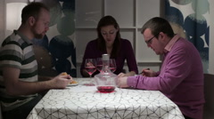 Three person having dinner at the table Stock Footage