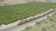 WS AERIAL ZO View of cargo train with tree area Stock Footage