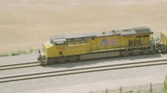 MS AERIAL ZO Cargo train running on track - stock footage