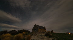 Timelapse of moving clouds at night at Church of the Good Shepherd, Tekapo Stock Footage
