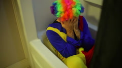 Crazy clown guy panic attack bath tub Stock Footage