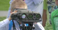A Child Looks Through Binoculars in Camera. Stock Footage