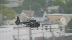 WS TS AERIAL View of helicopter with city - stock footage