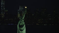 WS AERIAL ZO Night view of Statue of Liberty Stock Footage