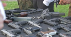 Men Demonstrate New and Old Kinds of a Fire-Arms - stock footage