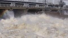 Rapid flow of  water with hydroelectric and rainbow Stock Footage