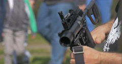 Two Men Holding Assault Rifles. Stock Footage