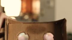 GoogleCardboard VR Put On POV Stock Footage