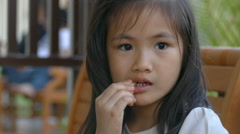 girl eating french fries - stock footage
