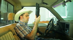 Guy in pickup truck looking at shotgun Arkistovideo