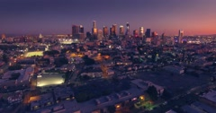 Scenic aerial view city downtown Los Angeles skyline sunset twilight dusk night Stock Footage