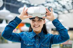 Woman wearing virtual reality glasses - stock photo