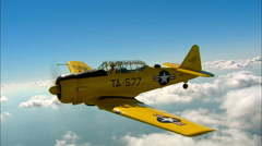 North American AT-6 Texan Air To Air Backlight Turn Stock Footage