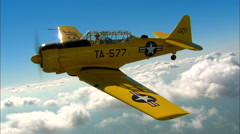 North American AT-6 Texan AirToAir Backlight Stock Footage