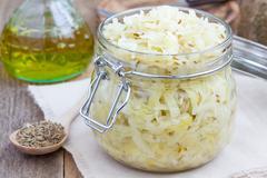 Homemade sauerkraut with cumin in a glass jar Stock Photos