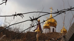 Barbed wire and Church Stock Footage