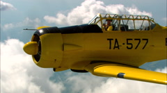 North American AT-6 Texan AirToAir Backlight Zoom Out Stock Footage