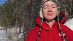 Beautiful woman smiling in winter Stock Footage