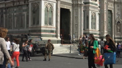Soldiers on guard among tourists, Duomo, Florence Stock Footage