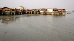 Penang clam jetty on stilts houses with ocean Stock Footage