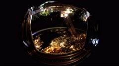 Planet Earth seen through the porthole  of the ISS. - stock footage