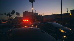 Ambulance fire truck flashing red lights rushing through busy street at night 4K - stock footage