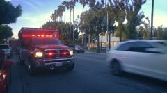 LOS ANGELES Ambulance fire truck flashing lights on Fairfax Boulevard Stock Footage