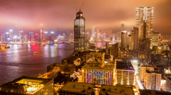 Hong Kong Cityscape Night Time lapse across Victoria Harbour Stock Footage