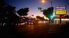 WEST HOLLYWOOD, CA: Traffic on Santa Monica Blvd at sunset 4K UHD Stock Footage