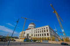 BERLIN, GERMANY - JUNE 06, 2015: Big cranes working on the reconstruction of Stock Photos