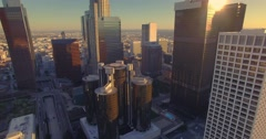 Aerial view downtown Los Angeles skyline skyscrapers Camera flying backward Stock Footage