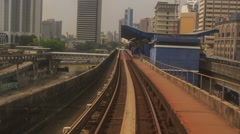Camera moves along KL Metro Rails among Skyscrapers Stock Footage