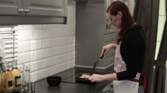 Woman fry the shrimp in a skillet Stock Footage