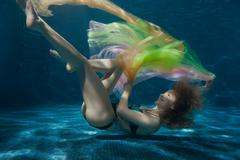 Woman with a tissue in the bottom pool. Stock Photos