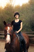 Happy Horsewoman ridding  in a Manege - stock photo