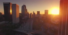 Aerial view of downtown Los Angeles skyline at sunset. Camera flying forward. 4K Stock Footage