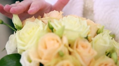 Wedding bouquet of flowers in hands of the bride on green background Stock Footage