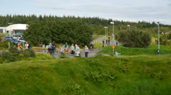 Residents of Reykjavik ride bicycles in the city park. Iceland Stock Footage
