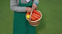 Child holding a toy basket with carrots Stock Footage